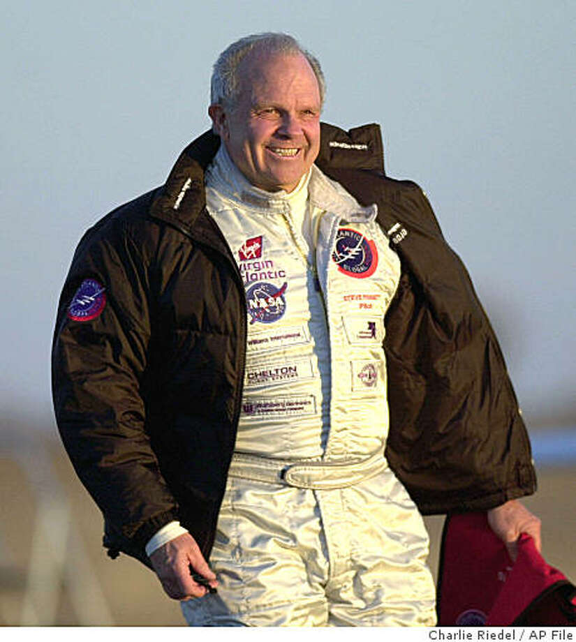 ** FILE ** In this Feb. 28, 2005 photo, pilot Steve Fossett walks across a windy runway to the GlobalFlyer at the Salina Municipal Airport in Salina, Kan. The hunt for multimillionaire adventurer Fossett, who vanished in September 2007 after taking off by plane from a remote Nevada ranch, resumes Monday, July 14, 2008, as a team of elite athletes and expert mountaineers starts hiking through rugged mountains on the California-Nevada border where he may have crashed. (AP Photo/Charlie Riedel, File) Photo: Charlie Riedel, AP