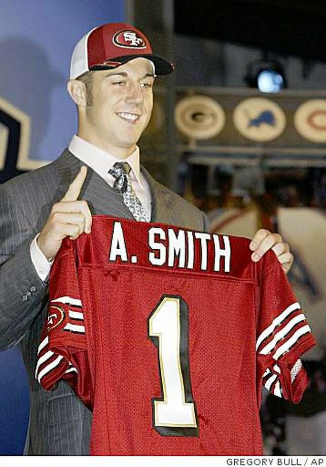 Utah quarterback Alex Smith holds up a San Francisco 49ers jersey after the 49ers selected him as the No. 1 overall pick in the NFL Photo: GREGORY BULL, AP