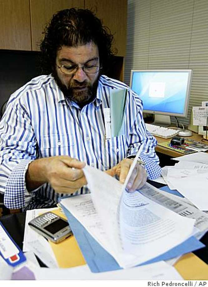 """Mike Jimenez, president of the California Correctional Peace Officers Association, looks over a petition to recall Gov. Arnold Schwarzenegger, at the CCPOA headquarters in West Sacramento, Calif., Monday, Sept. 8, 2008. The CCPOA announced Monday in the petition that they would begin take action to seek a recall of Schwarzenegger for """"catastrophic leadership failings and inept management.""""  (AP Photo/Rich Pedroncelli) Photo: Rich Pedroncelli, AP"""
