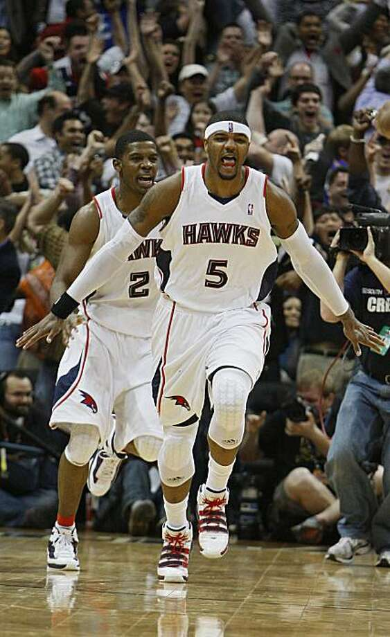 Atlanta Hawks' Josh Smith (5) and Joe Johnson (2) celebrate after Smith's game-winning basket at the buzzer to defeat the Orlando Magic 86-84 in an NBA basketball game Wednesday, March 24, 2010, in Atlanta. Photo: John Bazemore, AP