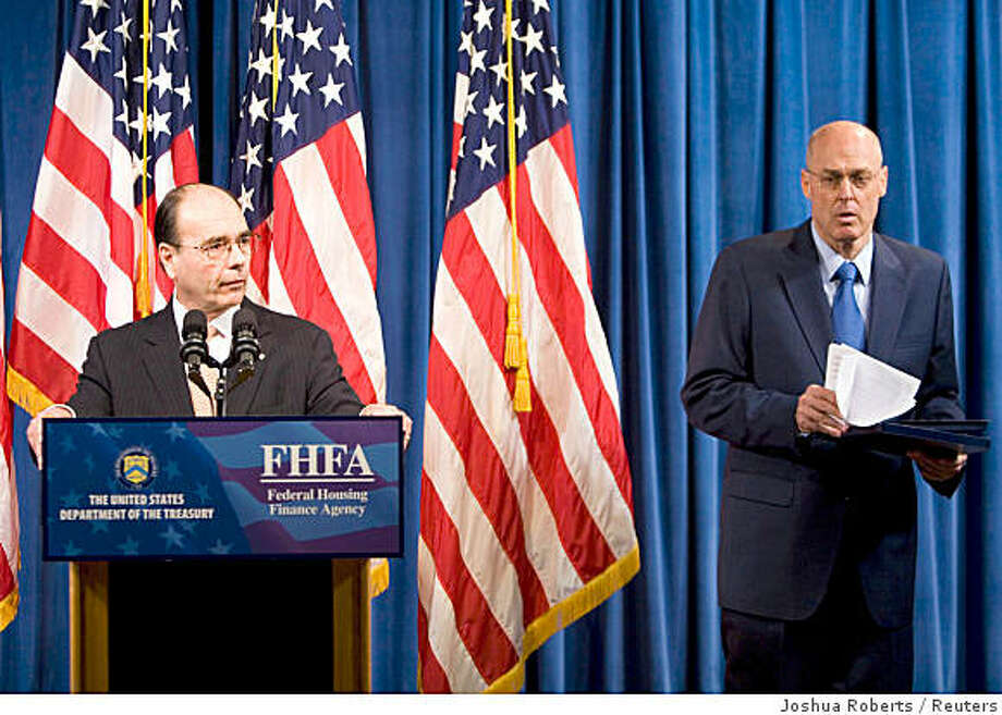 U.S. Secretary of the Treasury Henry Paulson (R) listens as Jim Lockhart, Director of the the new independent regulator, the Federal Finanace Agency (FHFA), speaks during a news conference, announcing that the government is taking control of mortgage finance companies Fannie Mae and Freddie Mac, at the Office of Management Supervision in Washington, DC, September 7, 2008.      REUTERS/Joshua Roberts     (UNITED STATES) Photo: Joshua Roberts, Reuters