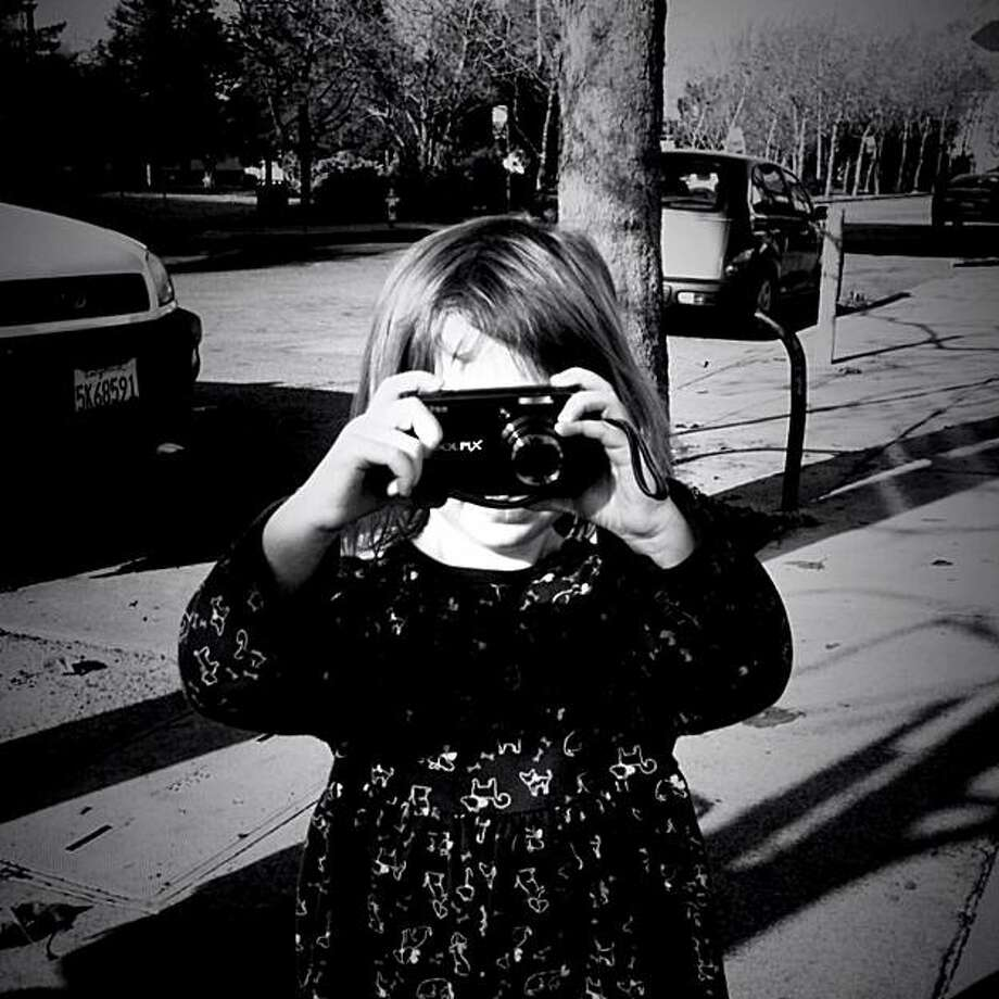 Ruby Ellenby, who is three years, old, has her first photography exhibit. Photo: Peter Ellenby