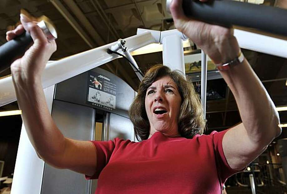 In this March 22, 2010 photo, Janet Katzin, 61, of Jericho, N.Y., uses a chest press to exercise at X-Sport gym at the Roosevelt Field Mall in Garden City, N.Y. Photo: Kathy Kmonicek, AP