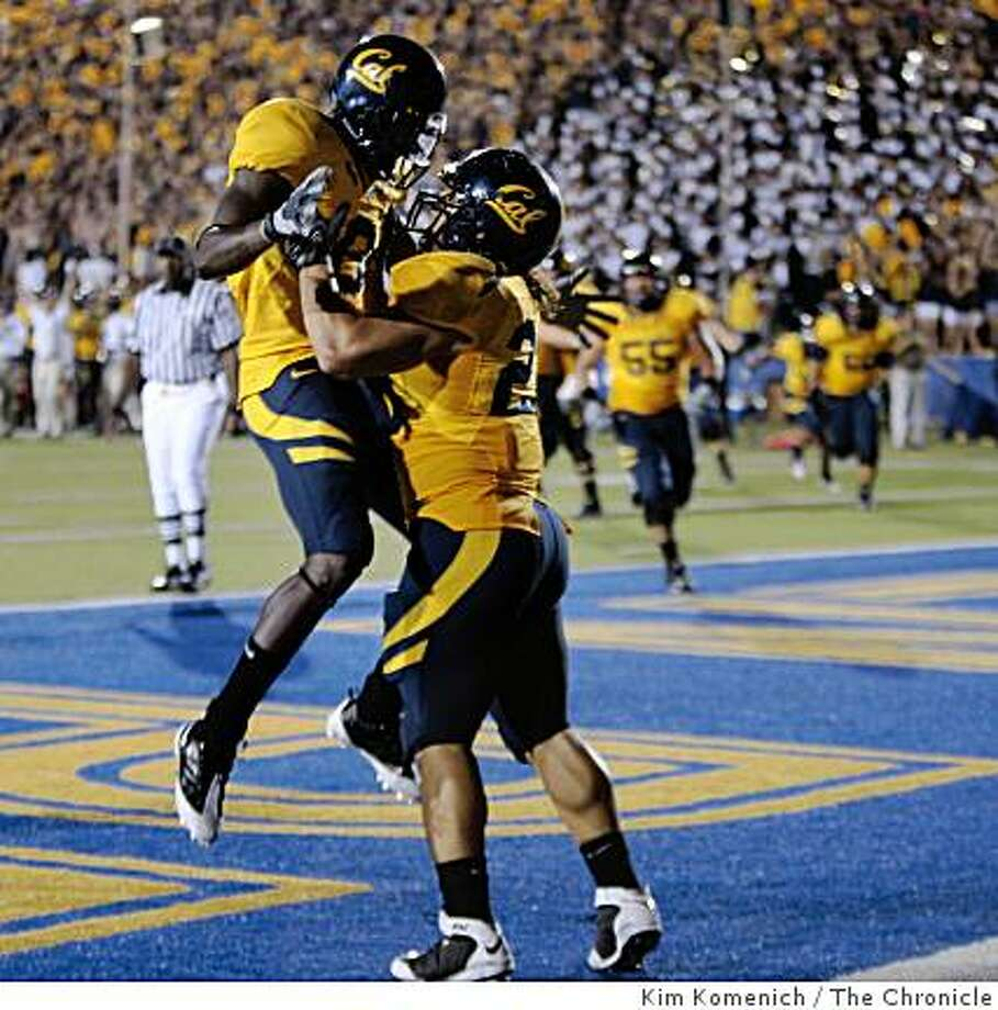 Cal's Nyan Boateng, left and Will Ta'ufo'ou rejoice after Ta'ufo'ou's fourht quarter touchdown as Cal plays Michigan State at Memorial Stadium in Berkeley Calif., on Saturday, Aug. 30, 2008. Photo: Kim Komenich, The Chronicle