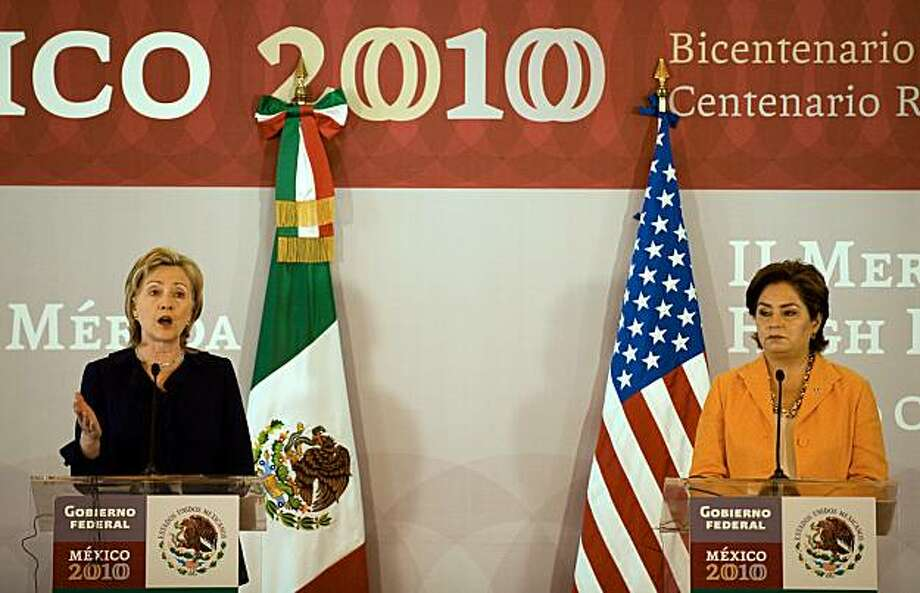 US Secretary of State Hillary Clinton (L) speaks next to her Mexican counterpart Patricia Espinosa during a joint press conference in Mexico City on March 23, 2010. A senior US delegation led by Secretary of State Hillary Clinton sought Tuesday to bolsterjoint efforts to tackle surging violence by Mexico's powerful drug cartels. Photo: Ronaldo Schemidt, AFP/Getty Images