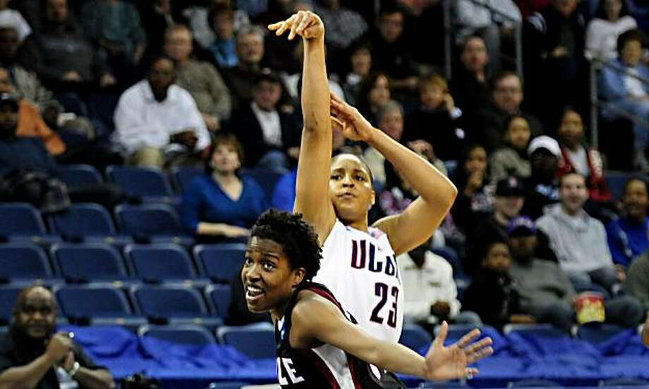 Connecticut's Maya Moore shoots a three pointer against Temple's Marli Bennett during the second round of the NCAA Women's Basketball Tournament at the Ted Constant Convocation Center at Old Dominion University in Norfolk, Virginia, Tuesday, March 23, 2010. Connecticut defeated Temple 90-36. (Bettina Hansen/Hartford Courant/MCT) Photo: Bettina Hansen, MCT
