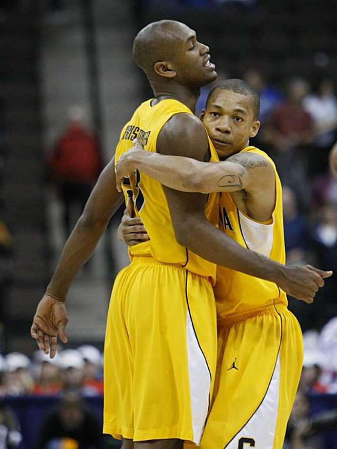 California guard Jerome Randle, right, hugs guard Patrick Christopher after California defeated Louisville 77-62 during an NCAA first round college basketball game Friday in Jacksonville, Fla. Photo: Wilfredo Lee, AP