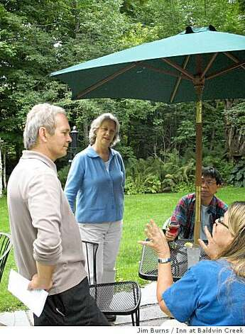 Inn at Baldwin owners Doug Mack and Linda Harmon speaking with guests in the garden. Photo: Jim Burns, Inn At Baldwin Creek