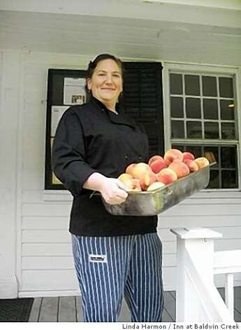 Sous chef Leah Pryor with a load of peaches from the Hudson Valley, New York. Photo: Linda Harmon, Inn At Baldwin Creek