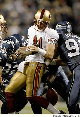 San Francisco 49ers quarterback Alex Smith (11) is sacked and loses the ball in the 1st quarter. Seattle recovered. The Seattle Seahawks host the San Francisco 49ers in a Monday night football game at Qwest Fleld in Seattle. Photo taken on 11/12/07, in Seattle, WA. Photo: Michael Maloney, SFC