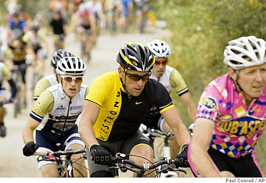 Seven-time Tour de France winner Lance Armstrong, center, starts the climb up Smuggler Mountain Road during the Smuggler/Hunter Creek mountain bike race Wednesday, Sept. 10, 2008, in Aspen, Colo. Armstrong is coming out of retirement to try to win an eighth Tour title in 2009. (AP Photo/The Aspen Times, Paul Conrad) ** MAGS OUT NO SALES  MANDATORY CREDIT ** Photo: Paul Conrad, AP