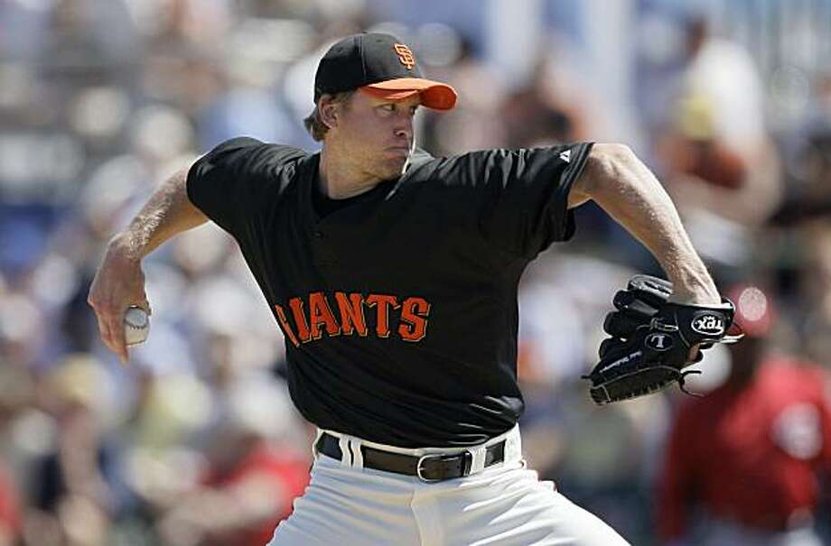 San Francisco Giants' Todd Wellemeyer pitches against the Cincinnati Reds in the first inning of a spring training baseball game in Scottsdale, Ariz., Saturday, March 20, 2010. Photo: Jeff Chiu, AP