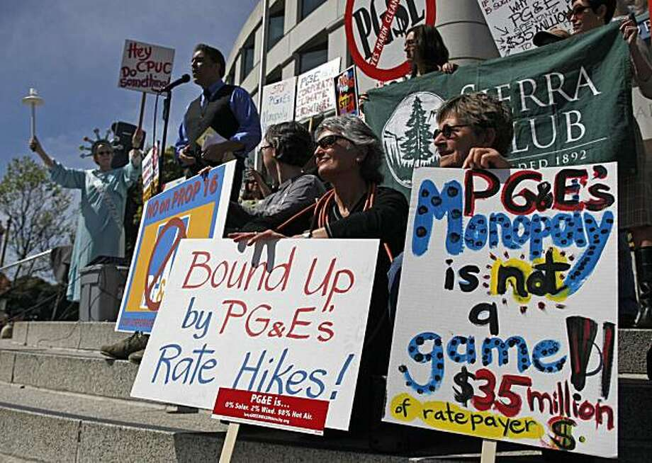 Kathy Callaway, second from right of Woodacre, Calif., and Julia Bartlett, right, of Pt. Reyes Station, Calif., take part in a protest against Proposition 16 outside the California Public Utilities Commission offices in San Francisco, Wednesday, March 17,2010. The California PUC heard public testimony Wednesday on a June ballot initiative that would make it much harder for local governments to create or expand public power agencies. Proposition 16 would change the state constitution to require a two-thirds vote before local governments can use taxpayer funds to create or expand publicly owned utilities. Photo: Eric Risberg, AP
