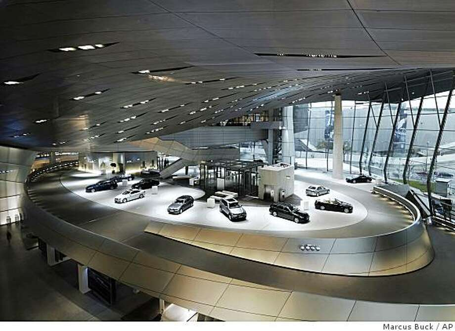 **FOR USE WITH SPECIAL EDITION**     This undated photo provided by BMW AG shows the interior of the BMW Welt facility in Munich, Germany. The BMW Welt is where BMW European delivery takes place.  Through a well-established but little-known program casually known in the industry as overseas delivery, buyers of a BMW, Mercedes-Benz, Audi, Porsche, Volvo or Saab can pick up their new car at the plant where it was made, drop it off at a port city for shipping _ and enjoy some serious road trip R&R along the way.   (AP Photo/BMW AG, Marcus Buck) **NO SALES** Photo: Marcus Buck, AP