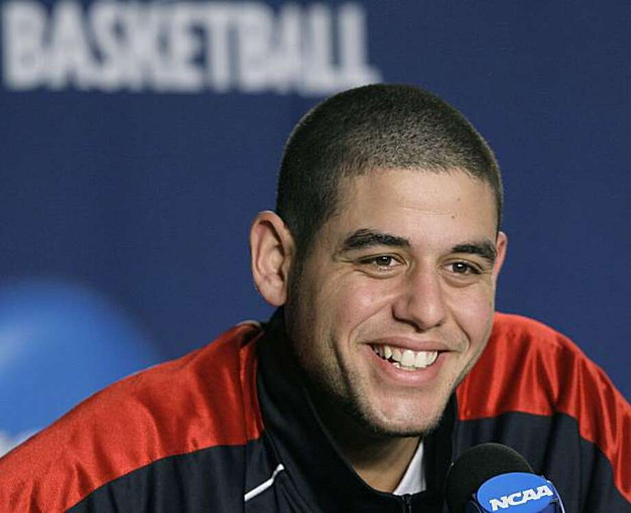 Saint Mary's Omar Samhan smiles during a news conference at the NCAA college basketball tournament in Providence, R.I. Friday, March 19, 2010. Saint Mary's will face Villanova  in a second-round game on Saturday. Photo: Elise Amendola, AP