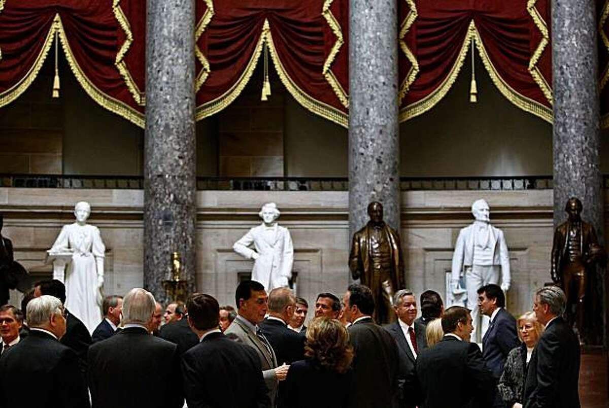 WASHINGTON - MARCH 18: Congressional Republicans gather in Statuary Hall before marching into House of Representatives Chamber for a bicameral strategy meeting at the U.S. Capitol March 18, 2010 in Washington, DC. With House Democrats saying they will move forward with a health care reform legislation vote as early as this weekend, Republicans have remained unified in their opposition to the bill.