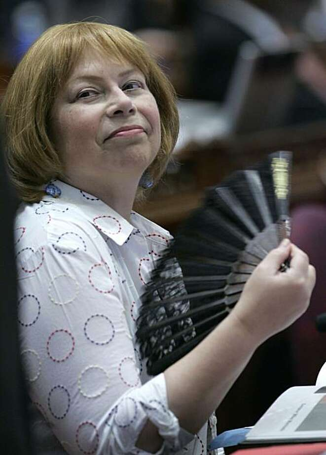 State Sen. Jenny Oropeza D-Long Beach uses a fan to stay cool during the Senate session Saturday August 30, 2008. (AP Photo/Rich Pedroncelli