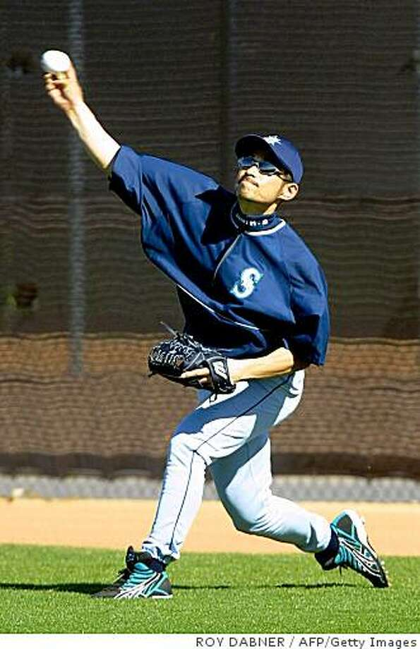 PEORIA, :  Seattle Mariners outfielder Ichiro Suzuki, throws to a cut-off man during the first day of full-squad practices, 20 February, 2002, at their Spring Training facility in Peoria, Arizona. AFP Photo/ROY DABNER (Photo credit should read ROY DABNER/AFP/Getty Images) Photo: ROY DABNER, AFP/Getty Images