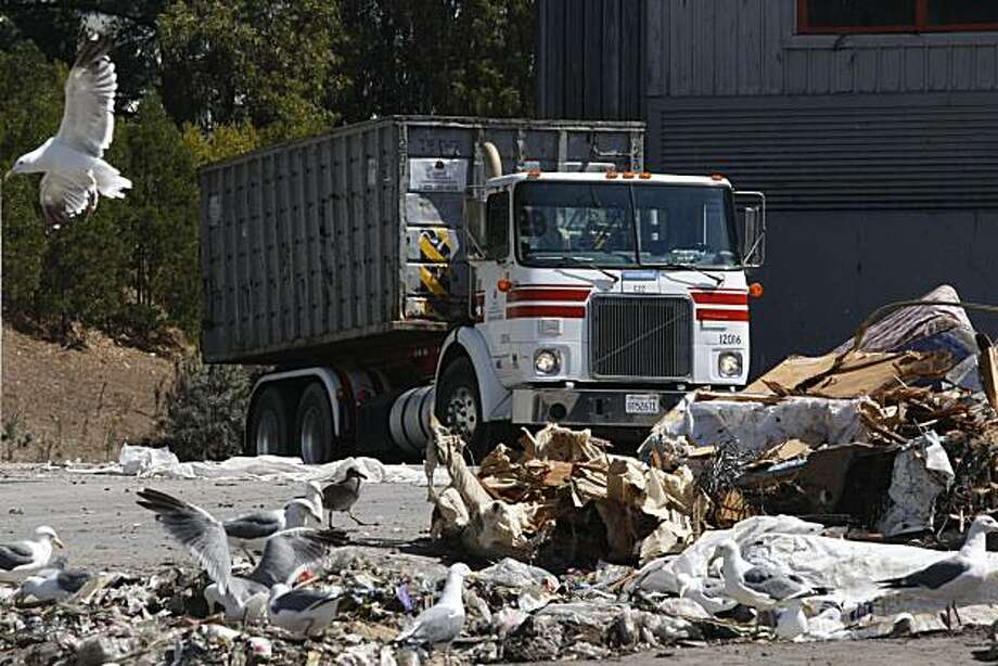 """A garbage trucks with Recology, San Francisco trash collection service, prepares to dump a load of trash at the Transfer station, nick named """"The Pit"""", on Friday Sep. 11, 2009 in San Francisco, Calif. Recology is now talking about changing there landfill location to Yuba County - located about 40 miles north of Sacramento. Photo: Mike Kepka, The Chronicle"""