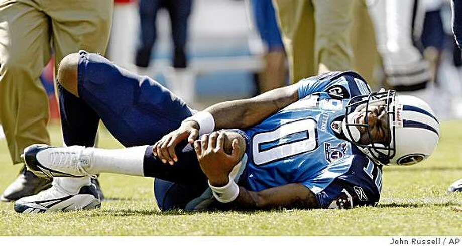 Titans quarterback Vince Young holds his knee after spraining it in the fourth quarter of an NFL football game against the Jacksonville Jaguars in Nashville, Tenn., Sunday, Sept. 7, 2008. The Titans won 17-10. Photo: John Russell, AP