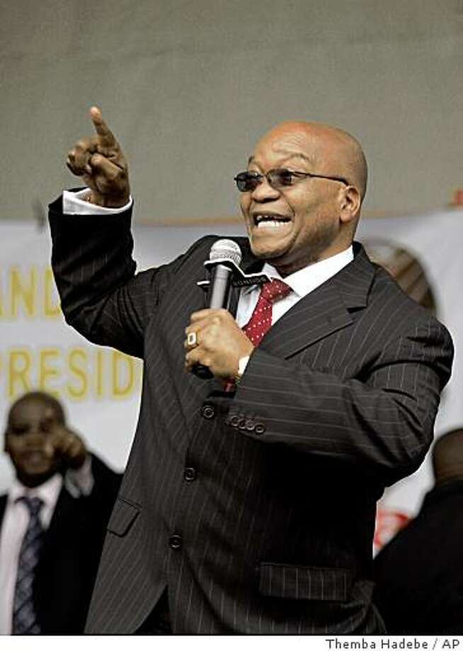 African National Congress President Jacob Zuma, reacts, outside the Pietermaritzburg High Court, South Africa, Friday Sept. 12, 2008. A South African judge ruled Friday that prosecutors were wrong to charge ANC President Jacob Zuma with corruption, effectively clearing the way for the 66-year-old former freedom fighter to become the country's next president. (AP Photo/Themba Hadebe) Photo: Themba Hadebe, AP