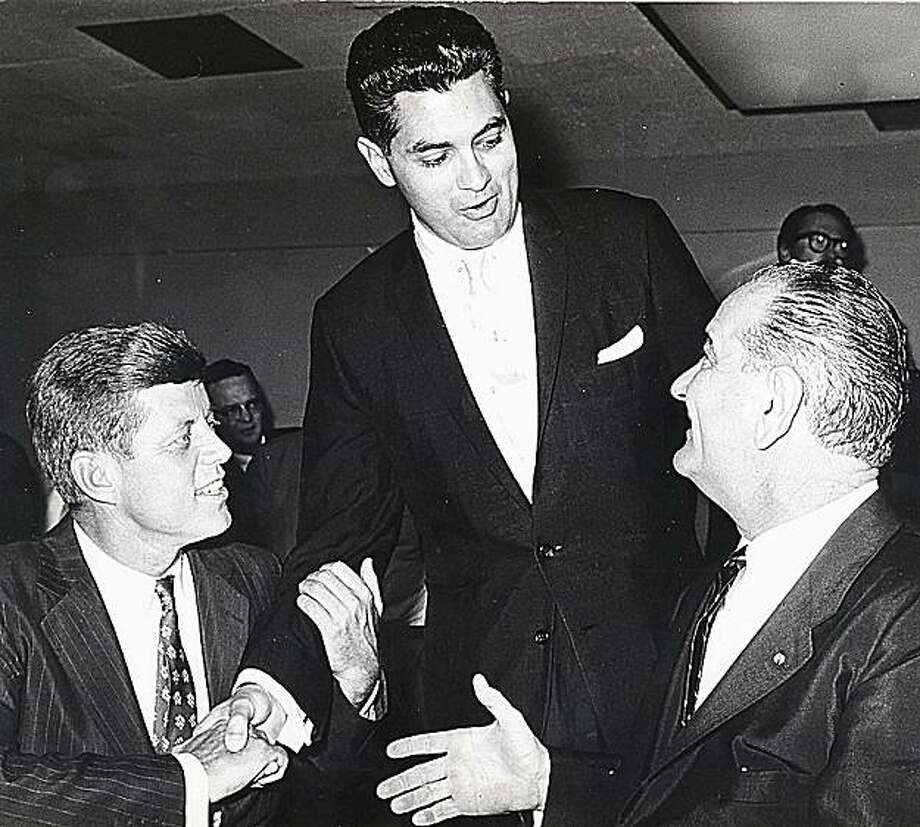 This Sept. 18, 1960 file photo, location unknown, shows District Attorney Edmund Dinis of the Southern District of Massachusetts, center, with running mates, Sen. John F. Kennedy, left, and Sen. Lyndon B. Johnson, right, at a breakfast meeting. Dinis, theformer district attorney who oversaw the investigation into the late Sen. Edward Kennedy's involvement in the Chappaquiddick case died Sunday, March 14, 2010, in Dartmouth, Mass.. He was 85. Photo: AP