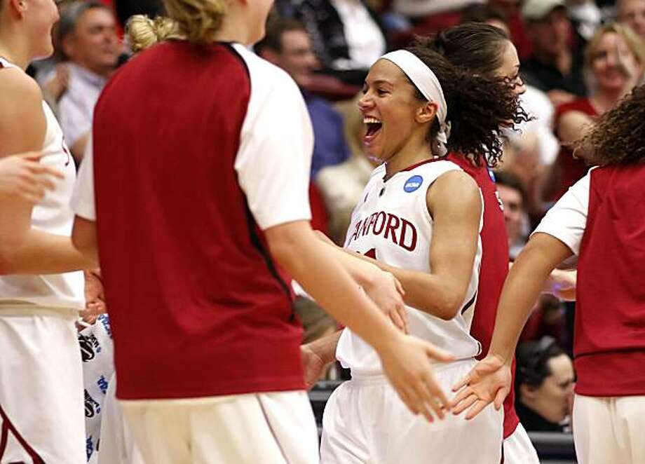 Stanford's Rosalyn Gold-Onwude (21) all smiles as she comes out of the game in the second half, leaving with 26 points as the Stanford Cardinal beat the the Iowa Hawkeyes   96-67 in second-round action in the 2010 NCAA Women's Basketball Championship at Maples Pavilion in Palo Alto, Calif. on Monday Mar. 22, 2010. Photo: Michael Macor, The Chronicle