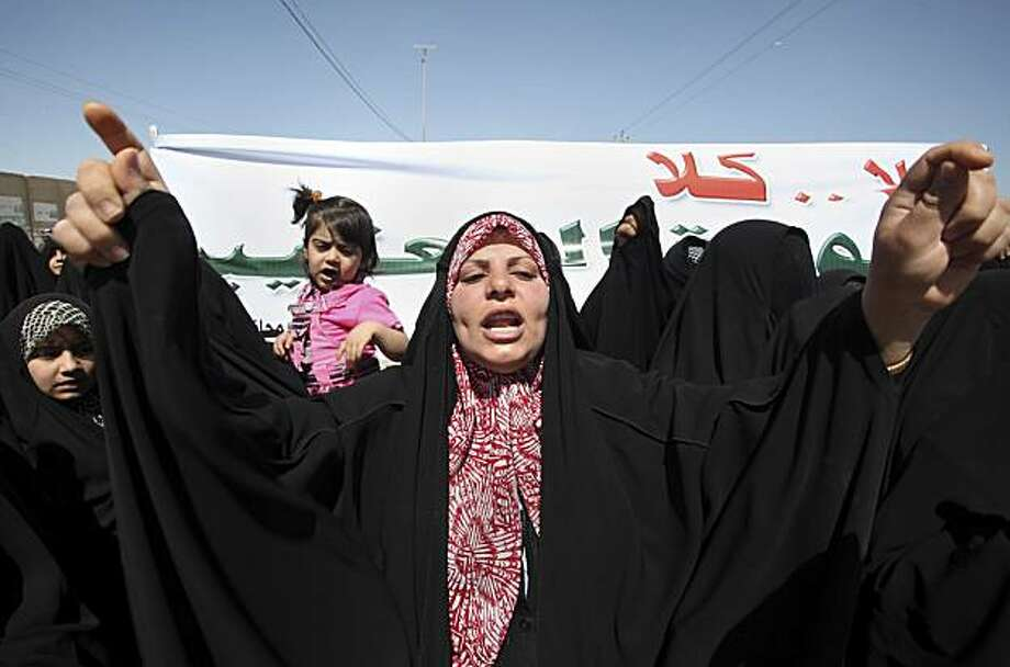 "An Iraqi woman chants anti-Baathist slogans at a protest in Najaf, south of Baghdad, Iraq, Sunday, March 21, 2010. Hundreds of residents protested outside the local government office demanding a manual recount of the elections. The banner in Arabic reads,""No for the return of the Baathists."" Photo: Alaa Al-Marjani, AP"