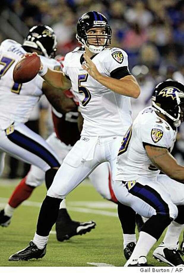 Baltimore Ravens quarterback Joe Flacco looks for an open receiver against the Atlanta Falcons in the first quarter of a preseason NFL football game Thursday, Aug. 28, 2008, in Baltimore. The Falcons won 10-9. (AP Photo/Gail Burton) Photo: Gail Burton, AP