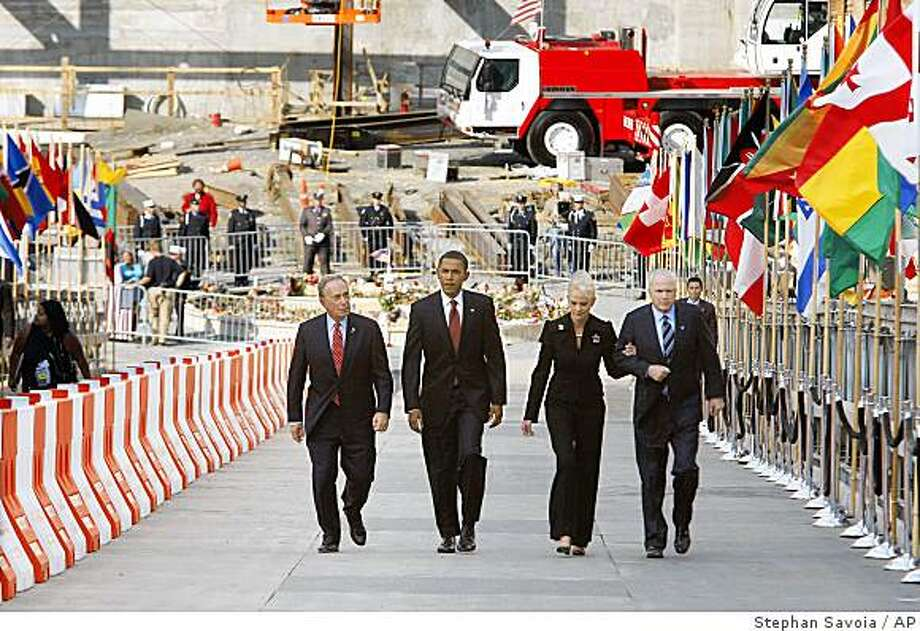 Republican presidential candidate, Sen., John McCain, R-Ariz., right,  his wife Cindy McCain, second from right, Democratic presidential candidate Sen., Barack Obama, D-Ill., second from left, and New York City Mayor Michael Bloomberg walk up a ramp after a Ground Zero 9/11 memorial observance Thursday afternoon, Sept. 11, 2008 in New York. (AP Photo/Stephan Savoia) Photo: Stephan Savoia, AP