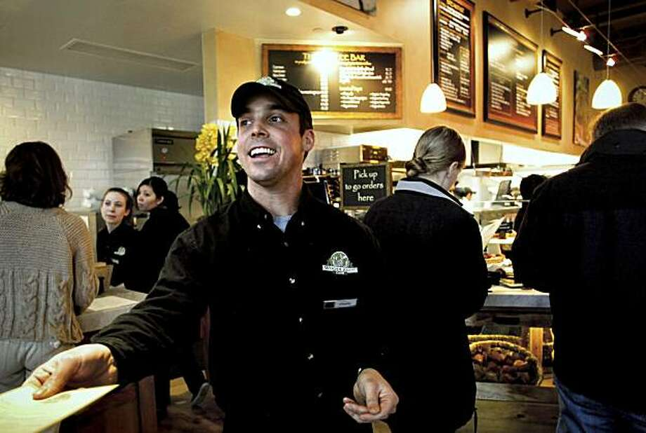 Charlie Hale, greets and hands out menus to customers at the Woodside Cafe in Kentfield, Calif., on Friday Mar. 12, 2010.  Hale, now 27-years-old, was in an auto accident at the age of 4 and suffered a brain injury. Today, he has a limp, a speech impediment and is slow in forming his sentences. He is very determined and  goal oriented despite the challenges he faces. Photo: Michael Macor, The Chronicle