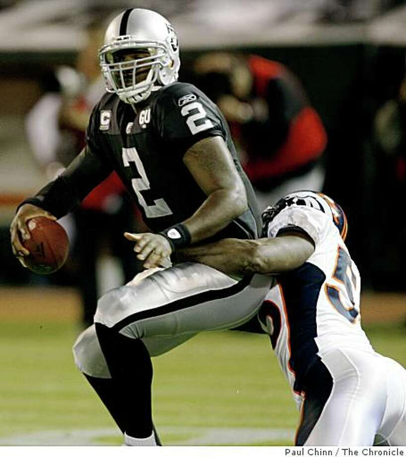 JaMarcus Russell is sacked by Denver's D.J. Williams in the second quarter of the Oakland Raiders vs. Denver Broncos NFL game at McAfee Coliseum in Oakland, Calif., on Monday, Sept. 8, 2008. Photo: Paul Chinn, The Chronicle
