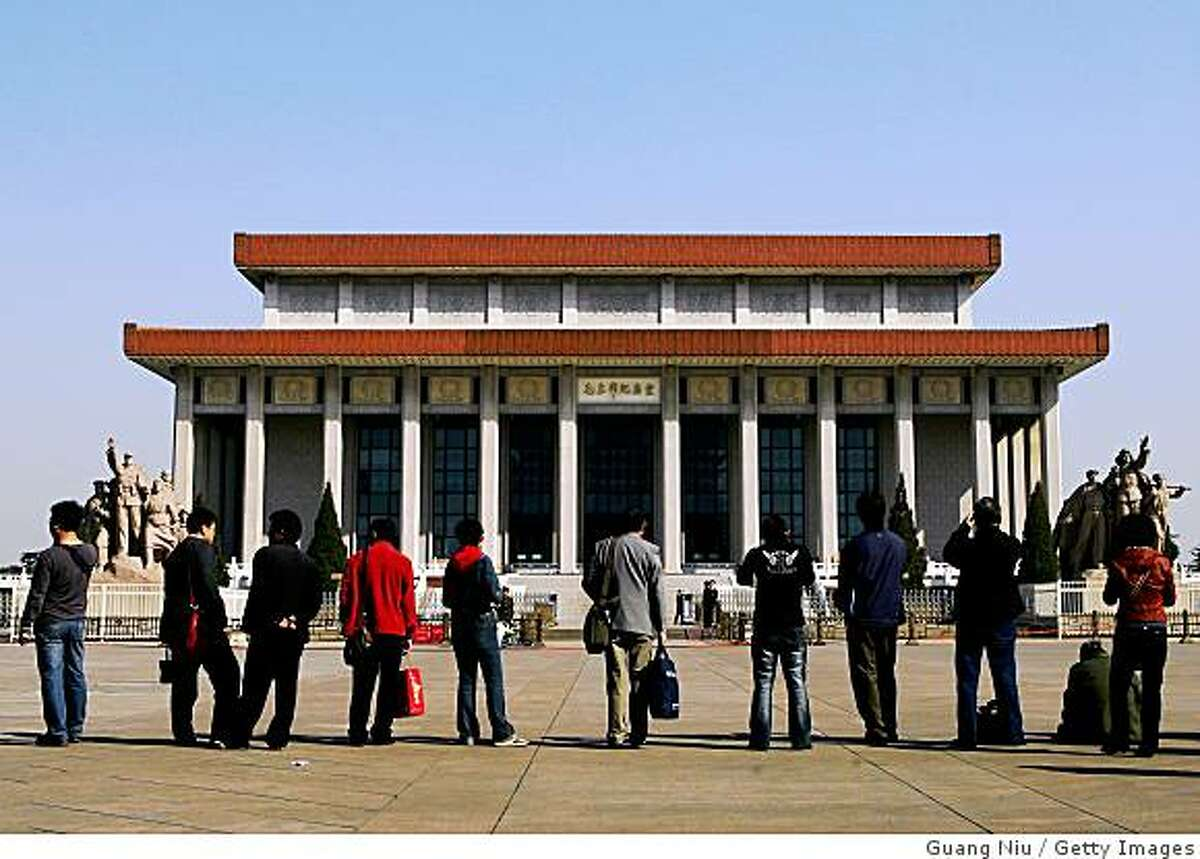 BEIJING - APRIL 04: People wait to pay their respects outside the Memorial Hall of late Chairman Mao Zedong (1893-1976) during the Qingming Festival on April 4, 2008 in Beijing, China. The Qingming Festival, also known as the