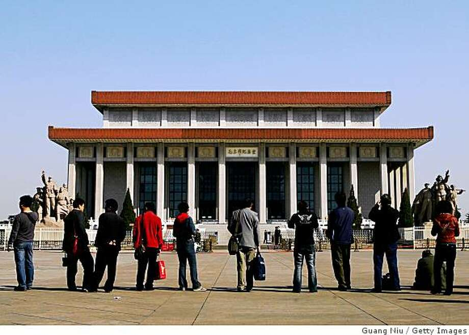 """BEIJING - APRIL 04:  People wait to pay their respects outside the Memorial Hall of late Chairman Mao Zedong (1893-1976) during the Qingming Festival on April 4, 2008 in Beijing, China. The Qingming Festival, also known as the """"Tomb Sweeping Day"""", which falls today is traditionally a time when people pay their respects to the deceased and their ancestors and often clean and repair tombs.  (Photo by Guang Niu/Getty Images) Photo: Guang Niu, Getty Images"""