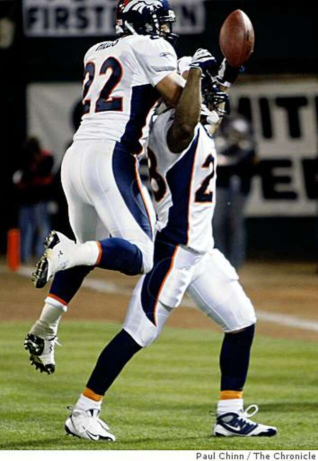 Denver's Michael Pittman (right) celebrates his second quarter touchdown with Peyton Hillis in the Oakland Raiders vs. Denver Broncos NFL game at McAfee Coliseum in Oakland, Calif., on Monday, Sept. 8, 2008. Denver led 17-0 at the half. Photo: Paul Chinn, The Chronicle