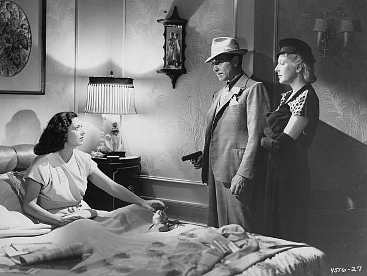 (From Left to Right) Kay Francis, Bernard Nadell, and Gertrude Michael in ALLOTMENT WIVES.