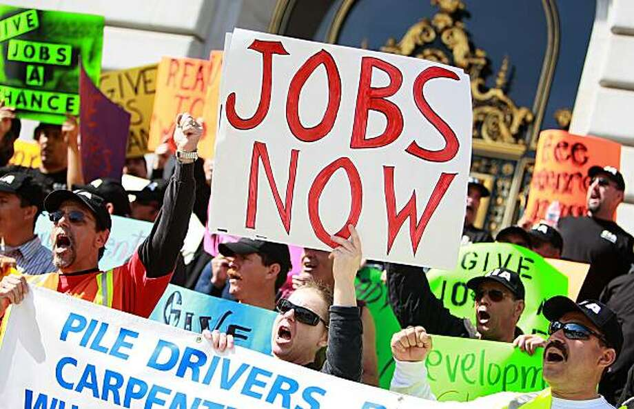 SAN FRANCISCO - MARCH 15:  Union workers hold signs during a rally in support of a proposed stimulus reform package for the City of San Francisco March 15, 2010 in San Francisco, California. Hundreds of union workers held a rally on the steps of San Francisco City Hall in support of a proposed stimulus reform package that would bring millions of dollars to the city to fund construction projects and create new jobs. Photo: Justin Sullivan, Getty Images