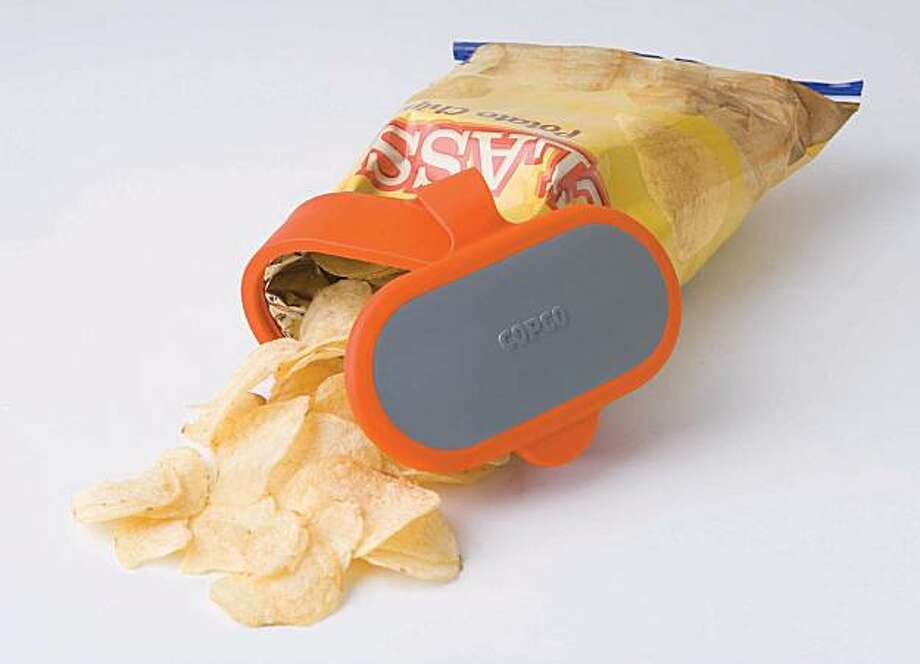 Copco bag caps fit over the opening of a plastic bag of snacks. Photo: Peter Rossi