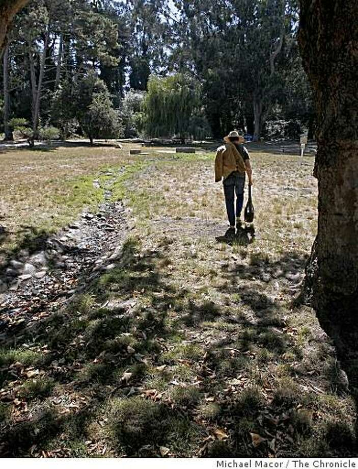 A San Francisco resident walks across the open space of the Tennessee Hollow watershed in the Presidio of San Francisco, Calif. on Sept. 5, 2008 where he enjoys days of watching birds or just relaxing in the surrounding area. Photo: Michael Macor, The Chronicle