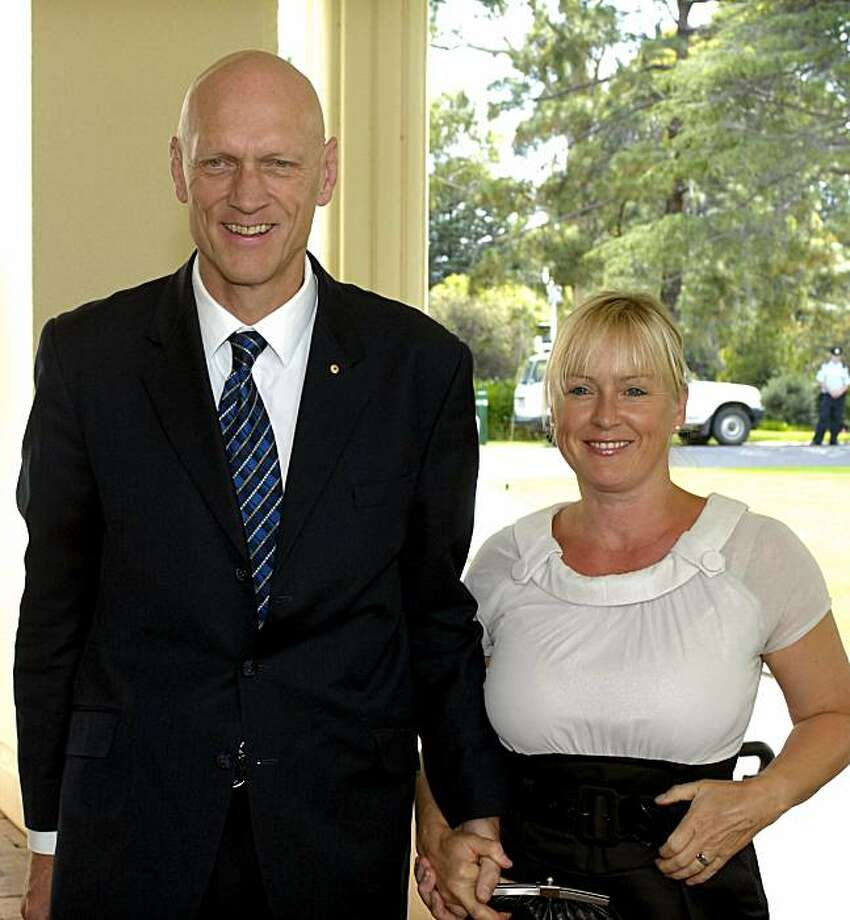 Peter Garrett, former front-man for the Australian rock band Midnight Oil, arrives with his wife Doris at Government House to be sworn in as Environment Minister in Canberra, Australia, in this Dec. 3, 2007 file photo. Photo: Mark Graham, AP