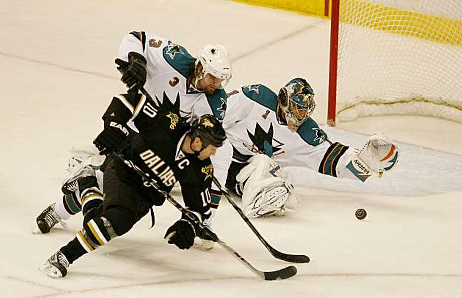 Dallas Stars' Brenden Morrow (10) joins San Jose Sharks goalie Thomas Greiss (1) and defenseman Douglas Murray (3) in a chase for a loose puck during the second period at the American Airlines Center in Dallas, Texas, on Tuesday, March 16, 2010. (Andy Jacobsohn/Dallas Morning News/MCT) Photo: Andy Jacobsohn, MCT
