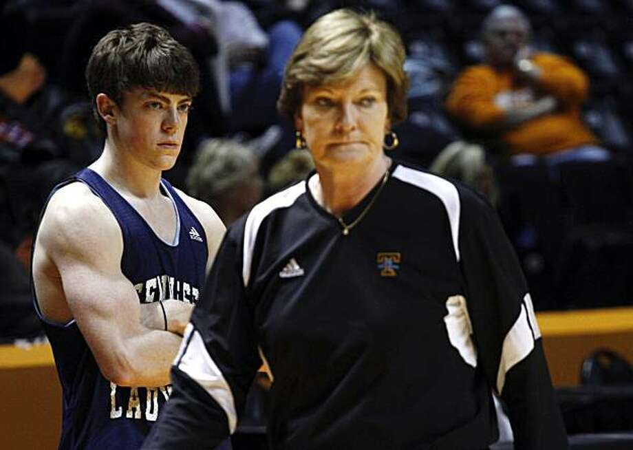 In this photo taken on Feb. 24, 2010, Tyler Summitt, left, watches as his mother, Tennessee women's basketball coach Pat Summitt walks past, during practice Wednesday, Feb. 24 , 2010 in Knoxville, Tenn.  Tyler now works with the Tennessee Lady Vols as a practice player and has ambitions of following his mom into coaching. Photo: Wade Payne, AP