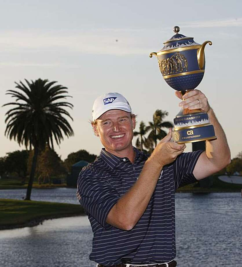 Ernie Els, of South Africa, holds up his trophy after winning the CA Championship golf tournament in Doral, Fla., Sunday, March 14, 2010. Photo: Alan Diaz, AP