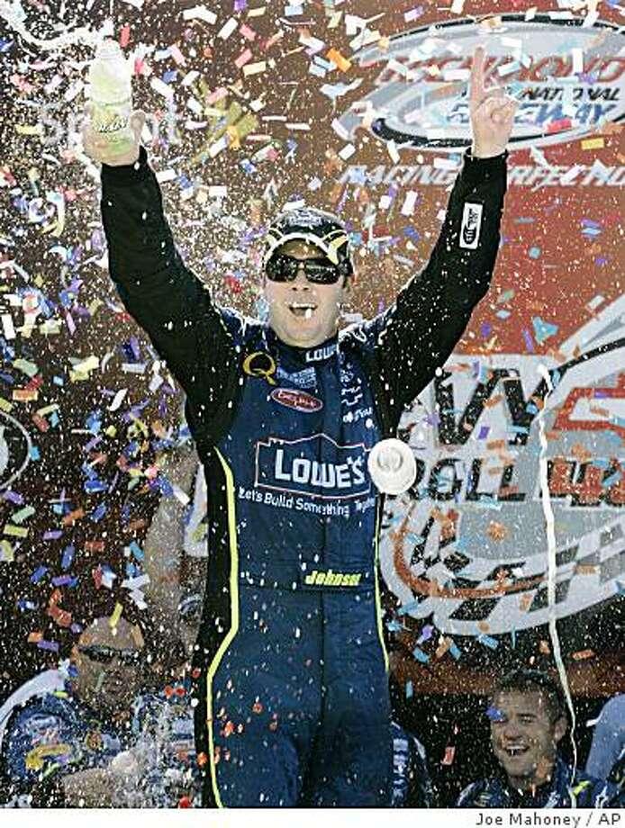 Jimmie Johnson is showered with confetti after winning the NASCAR Sprint Cup Series' Chevrolet Rock & Roll 400 auto race at Richmond International Raceway on Sunday, Sept. 7, 2008, in Richmond, Va. (AP Photo/Richmond Times-Dispatch, Joe Mahoney) Photo: Joe Mahoney, AP