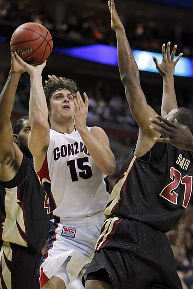 Gonzaga's Matt Bouldin (15) shoots under pressure from Florida State's Michael Snaer (21) during the second half of an NCAA first-round college basketball game in Buffalo, N.Y.,Friday, March 19, 2010. Gonzaga won 67-60. Photo: Mike Groll, AP