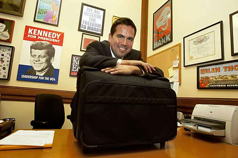 Recently snatched garment bag of Sacramento Mayor Kevin Johnson has been recovered and is in the hands Mayor Newsom spokesman, Nathan Ballard, in San Francisco Calif., on Tuesday, October 13, 2009. Photo: Liz Hafalia, The Chronicle