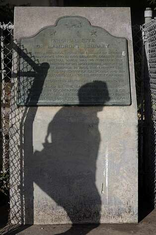 The shadow of a pedestrian walking on Valencia Street passes by the  plaque marking the original site of the Bancroft Library in San Francisco, Calif. on Thursday, March 18, 2010. Photo: Lea Suzuki, The Chronicle