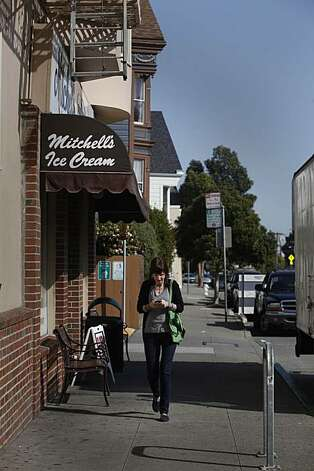 Kora Thomas of San Francisco checks her phone while walking past Mitchell's Ice Cream on San Jose avenue in San Francisco, Calif. on Thursday, March 18, 2010. Photo: Lea Suzuki, The Chronicle