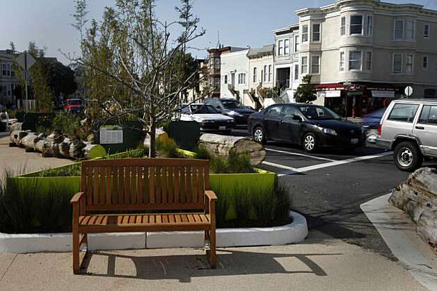 An empty bench is seen at a Guerrero Park in San Francisco, Calif. on Thursday, March 18, 2010 while in the background at right traffic is seen moving on Guerrero street. Photo: Lea Suzuki, The Chronicle