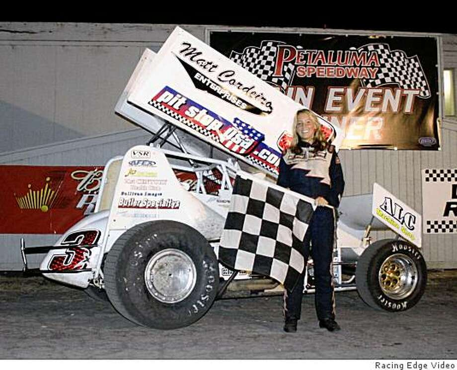 Alissa Geving, a senior at at Ursiline High School in Santa Rosa, is the youngest U.S. champ of the 360-winged Sprint car series in dirt track auto racing.  Shown here with her car. Photo: Racing Edge Video